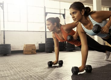women's only gym with women working out with weights