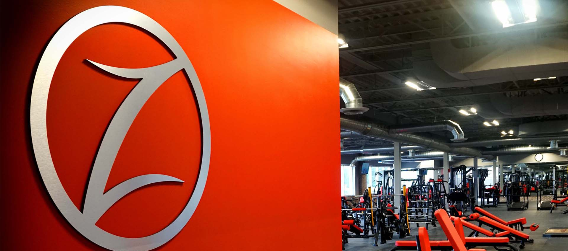 fuzion fitness logo and gym floor area