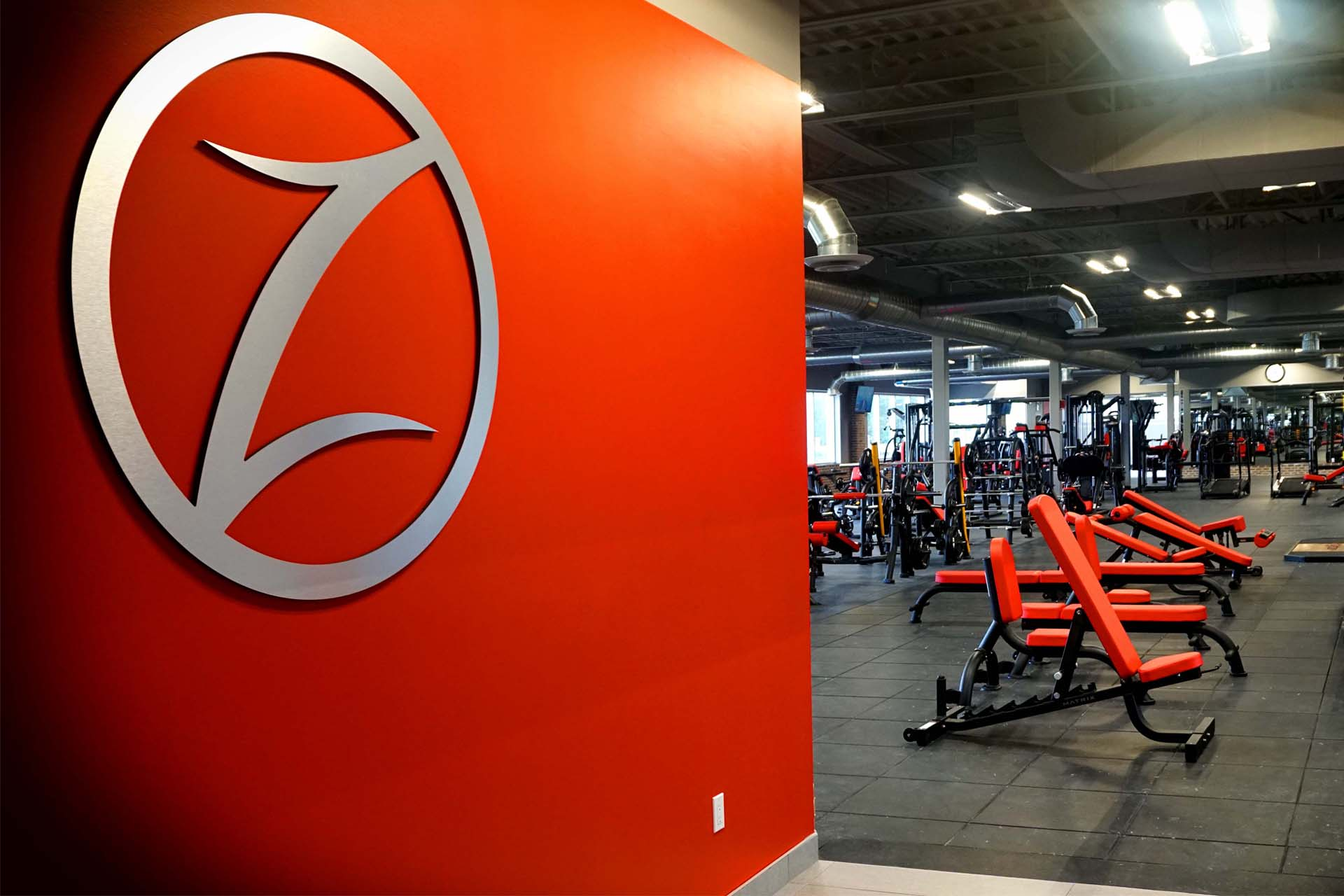 logo of fuzon fitness center along with workout area