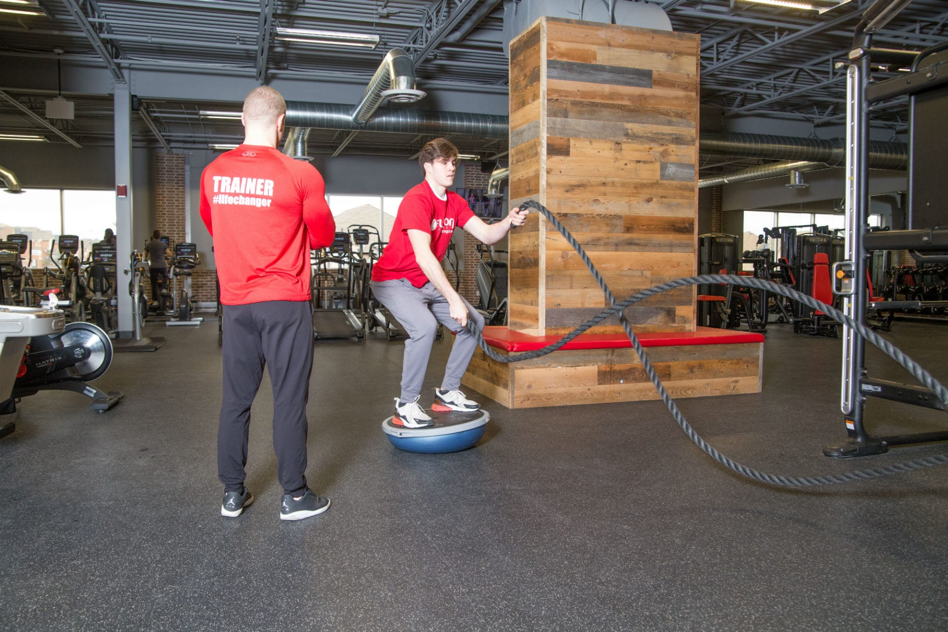 gym member receiving personal training at gym