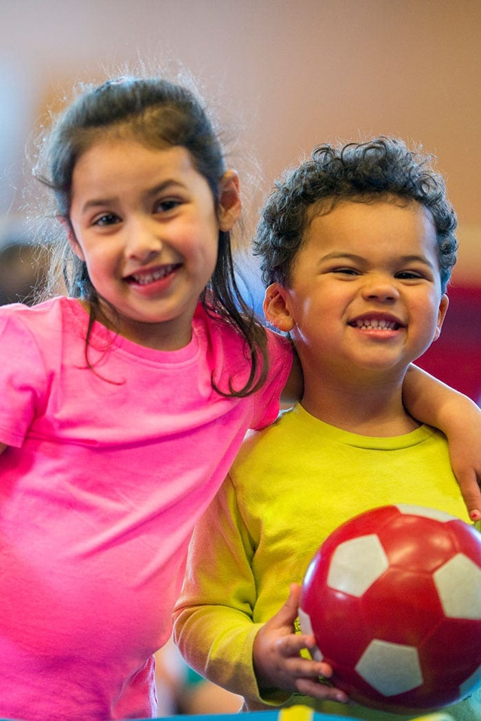 happy-children-in-childcare-at-fitness-center-gym