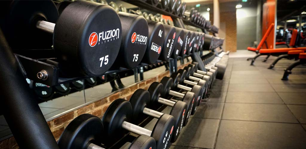 free weights in a row at fuzon fitness