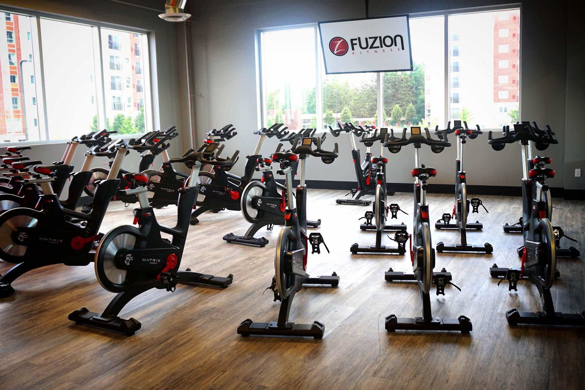 stationary bikes facing the window for group cycling classes