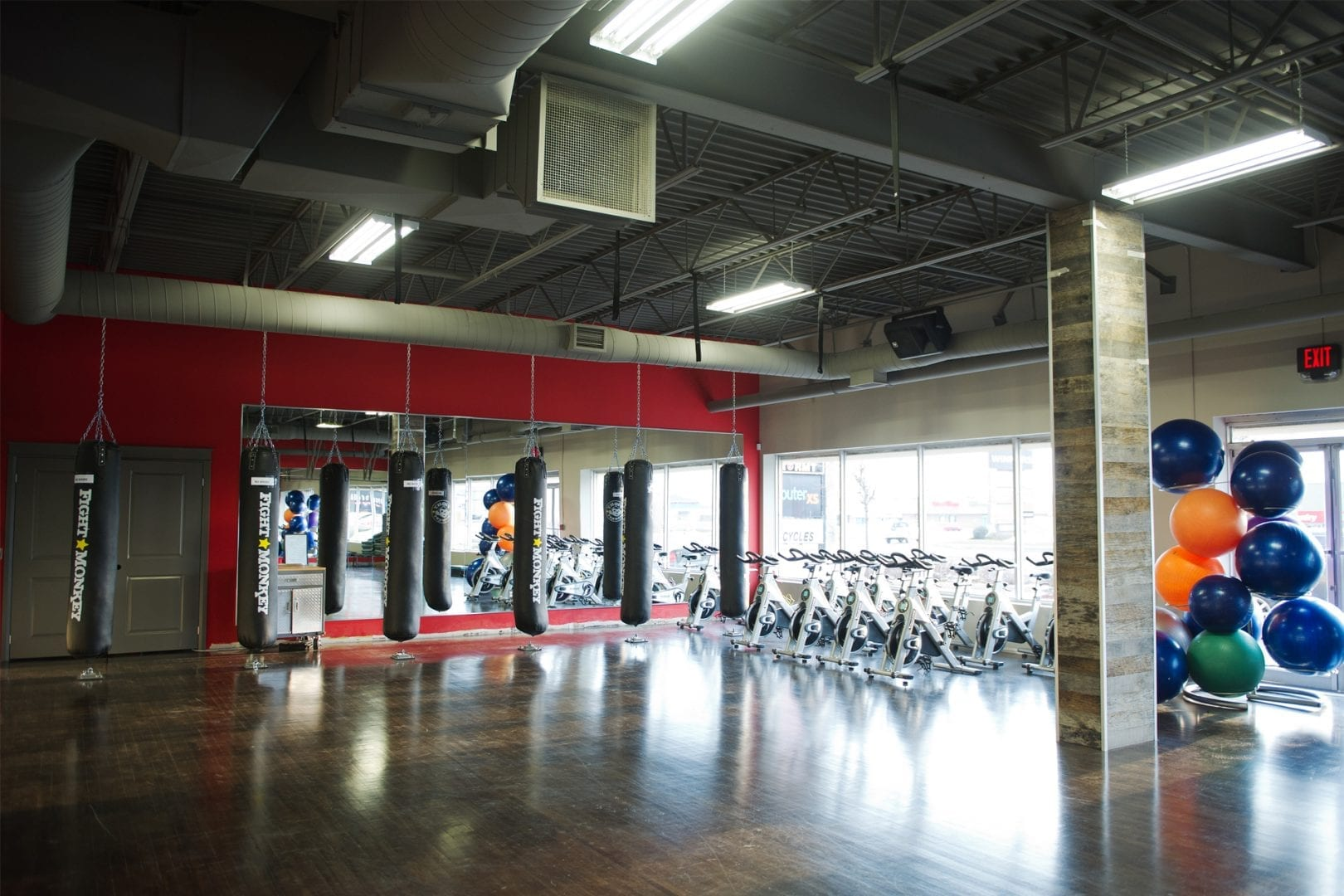 boxing-bags-fitness-balls-stationary-bicycles-in-gym
